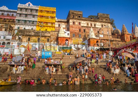 VARANASI, INDIA - MARCH 23: Hindu pilgrims take holy bath in the river ganges on the auspicious Maha Shivaratri festival on March 23, 2013 at Dasashwamedh ghat in Varanasi, Uttar Pradesh, India - stock photo