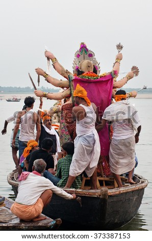 VARANASI, INDIA-03 OCT, 2014: An annual Hindu festival in South Asia that celebrates worship of the Hindu goddess Durga at Dashashwamedh Ghat on the banks of the river Ganges in Varanasi - stock photo