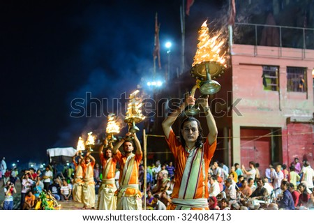 VARANASI, INDIA-September 14 , 2015: A Hindu priest performs the Ganga Aarti ritual in Varanasi.Fire puja is a Hindu ritual that takes place at Dashashwamedh Ghat on the banks of the river Ganges - stock photo