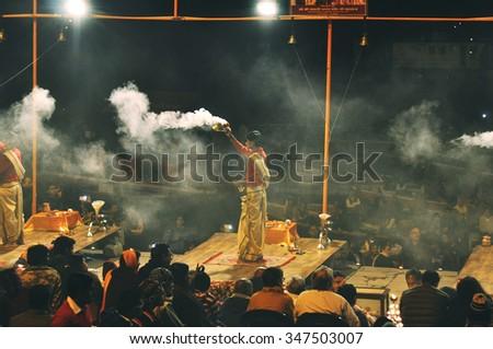 VARANASI  - JAN 04: Hindu priest performs religious Ganga Aarti ritual (fire puja) at Dashashwamedh Ghat in Varanasi on January 04. 2015 in India - stock photo
