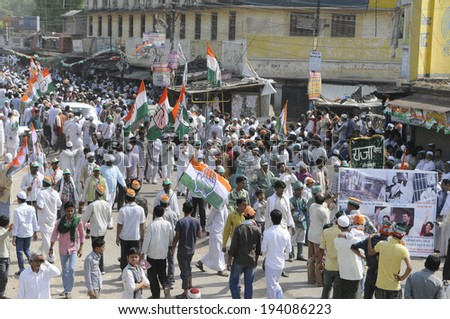VARANASI - MAY 10: Congress party flags flying high during a road show  to support local Congress candidate Mr. Ajay Rai on May 10, 2014 in Varanasi , India. - stock photo