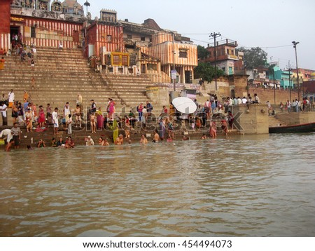 Varanasi, Uttar Pradesh, India - October 2011: View of the banks of the Ganges River with devotees and visitors. - stock photo