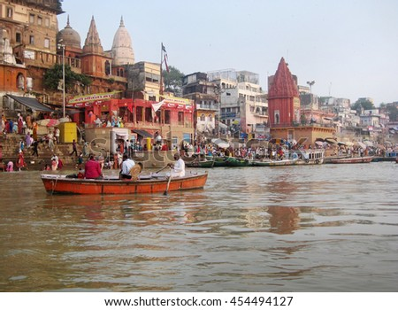 Varanasi, Uttar Pradesh, India - October 2011: View of the Ganges River banks with temples, devotees and visitors. - stock photo