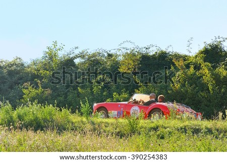 VARANO (PR), ITALY - SEPTEMBER 18: A bright red MG A Roadster takes part to the GP Nuvolari classic car race on September 18, 2015 near Varano (PR). The car was built in 1957. - stock photo