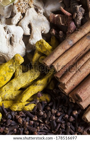 variation of dried spices on wood - stock photo