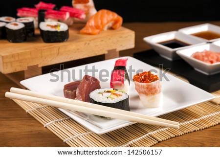 Variation of fresh tasty sushi food - stock photo
