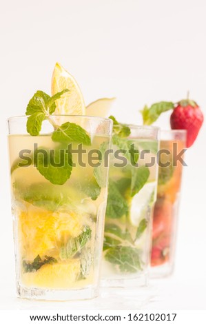 Variation of Mojito cocktails over white background  - stock photo