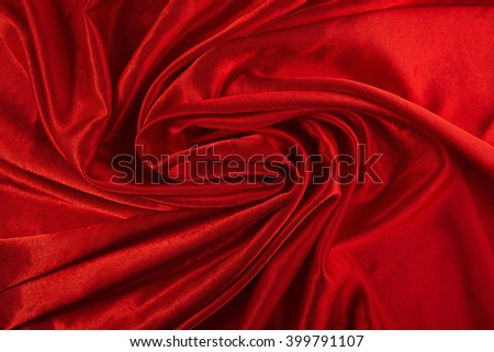 Variation of scene-background with red velvet with spiral folds. - stock photo