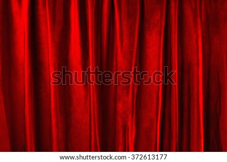 Variation of scene-background with red velvet with straight vertical folds. - stock photo