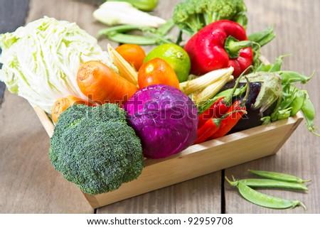 Varieties of Vegetables in wood tray - stock photo