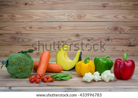 Variety fresh vegetable on wooden background. - stock photo