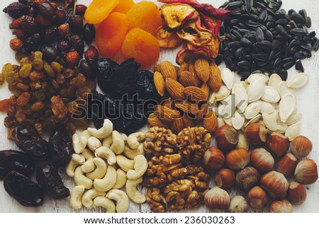 Variety of 12 assorted nuts and dried fruits, top view - stock photo