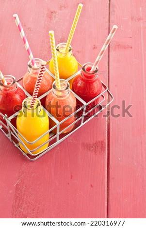Variety of breakfast smoothie in little vintage bottles - stock photo