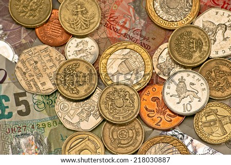 Variety of British pounds and pennies money - stock photo