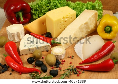 Variety of cheese: camembert, gouda, brie, parmesan,  sheep and other hard cheeses - stock photo
