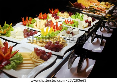Variety of cheese on plates - stock photo