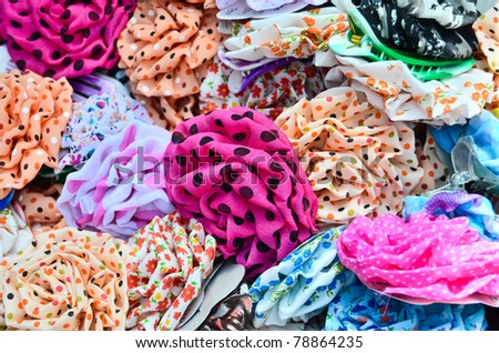 Variety of colorful hair accessories in the market - stock photo
