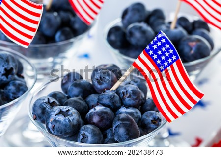 Variety of desserts on the table for July 4th party. - stock photo