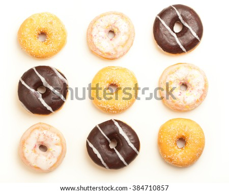 Variety of donuts, high angle view from above in three by three pattern. - stock photo