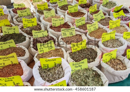 Variety of dry spices for sale in a market in France - stock photo