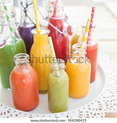 Variety of fresh smoothies in rainbow colors - stock photo