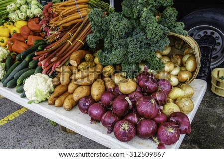Variety of fresh vegetables on display at a farmer's market, late spring in northern Illinois, USA - stock photo