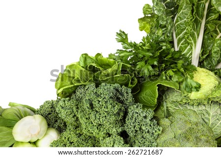 Variety of green vegetables, over white background.   - stock photo