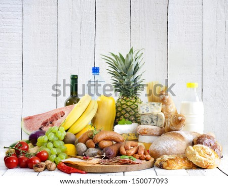 Variety of grocery products fruits vegetables meat cheese and bread - stock photo