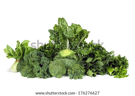 Variety of leafy green vegetables isolated on white background. - stock photo