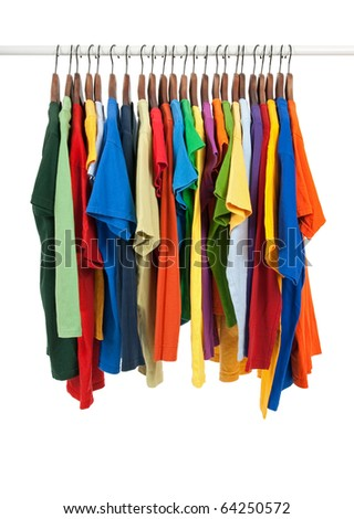 Variety of multicolored casual shirts on wooden hangers, isolated on white. - stock photo