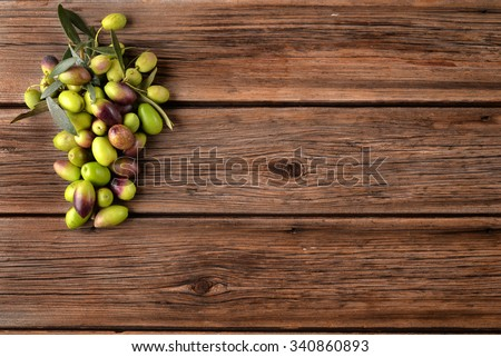 Variety of olives on old wood planks - stock photo