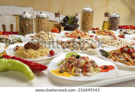 Variety of prepared pasta served on the table. - stock photo
