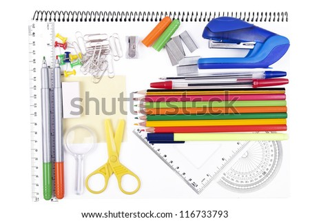 variety of school items on notebook - stock photo