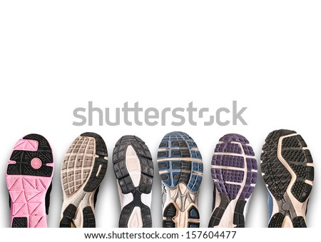 Variety of shoes./ Different shoe sole isolated on white. - stock photo