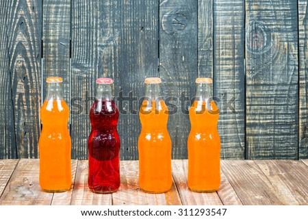 variety of soda bottle on the wooden background - stock photo