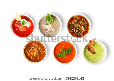 Variety of soups, restaurant hot dishes, healthy food. Japanese miso soup, asian fish soup, russian borscht, english pea soup, mushroom soup, spanish gazpacho isolated at white. Top view, flat lay. - stock photo