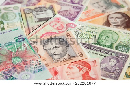 Variety of South American banknotes - stock photo