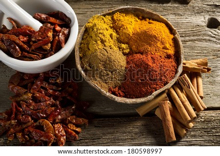 variety of spice on wood background - stock photo