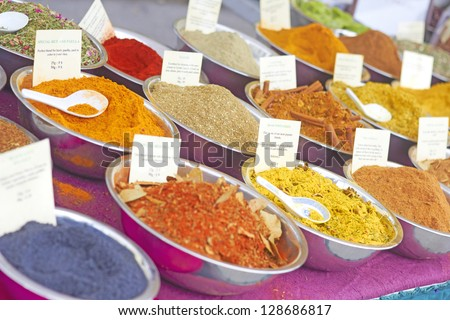 Variety of spices for sale at the market. Horizontal Shot. - stock photo