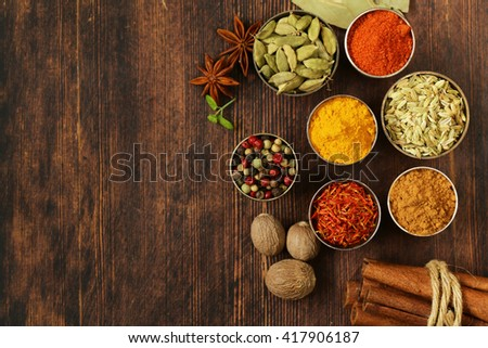 variety of spices (saffron, paprika, pepper, fennel, cinnamon, turmeric, nutmeg) - stock photo