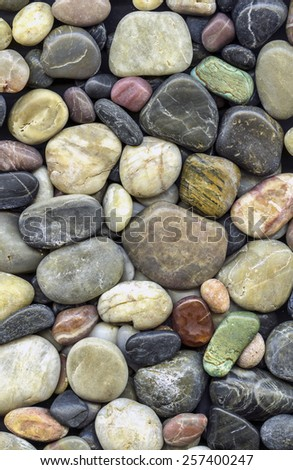 variety of stones laid out as wallpaper all stones have been polished - stock photo