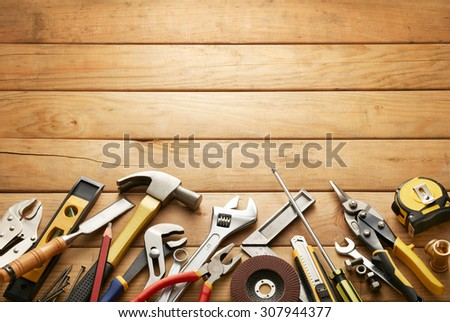variety of tools on wood planks with copy space - stock photo