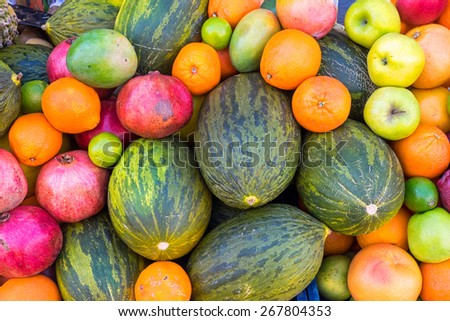 Variety of tropical fruits seen at a market - stock photo