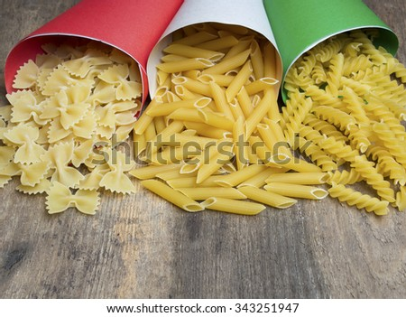 Variety of types and shapes of Italian pasta in paper envelopes Italy flag color .selective focus image, room for text - stock photo