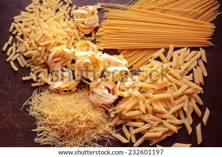 Variety of types and shapes of pasta - stock photo