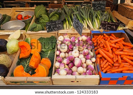 Variety of vegetable groceries in crates at market - stock photo