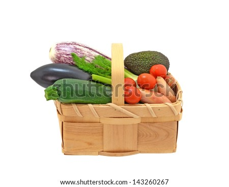 Variety of vegetables in basket - stock photo