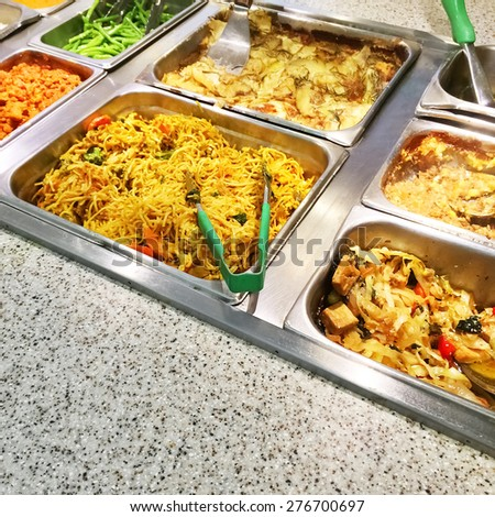 Variety of vegetarian food in metal containers in a catering buffet. - stock photo