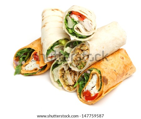 Variety of wrap sandwiches with chicken and cheese. - stock photo