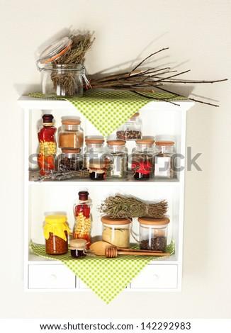 Variety spices on kitchen shelves - stock photo